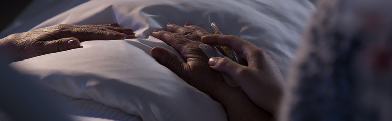 Person assisting dying hospice patient