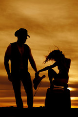 silhouette cowgirl on barrel hair blowing