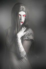 Dark fine art portrait. Beautiful vampire woman