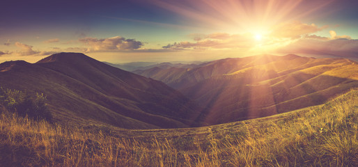 Panoramic  landscape in autumn mountains with sunlight.