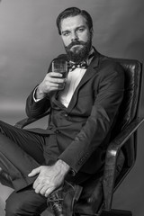 Portrait of an elegant young fashion man with retro look sitting