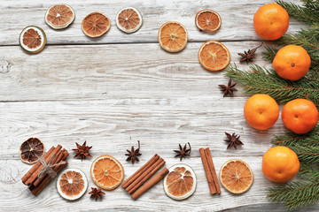 Mandarins with  cristmas tree branch  with cinnamon, anise on white wooden background