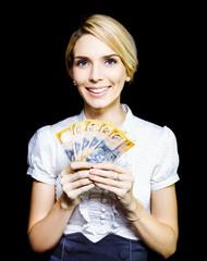 Business woman holding a cash bonanza
