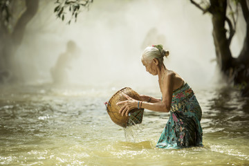 old woman looking for fish streams.