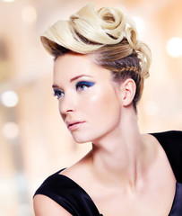 woman with fashion  hairstyle and blue eye makeup