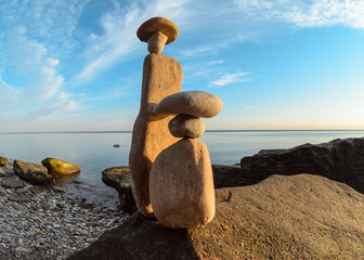 Symbolic figurines on seashore