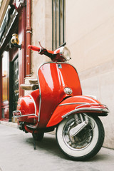 Red retro scooter on the european street