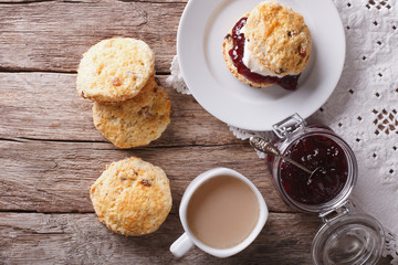 British scones with jam and tea close-up. Horizontal top view