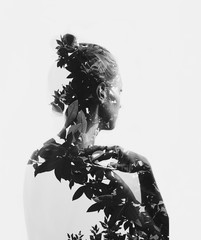 Creative double exposure portrait of attractive girl with branches of tree