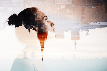 Creative double exposure portrait of attractive woman with city