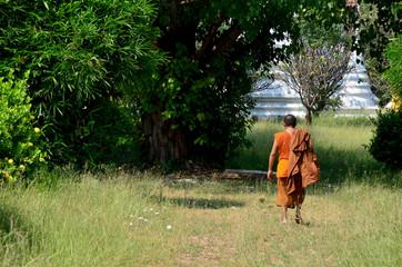 Monk walking at Prasat Nakhon Luang Temple
