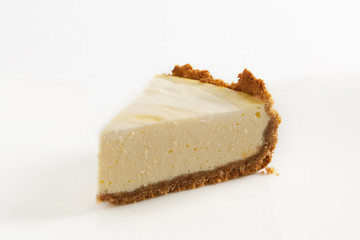 Slice of cheesecake on a white background