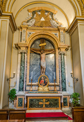 Marmara crucifixion of Jesus Christ on the altar for prayer with the icon which depicts Christ in Basilica di San Giovanni in Laterano in Rome, capital of Italy