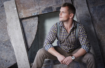 Attractive brutal man in checkered shirt.