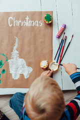 Little boy making Christmas decorations