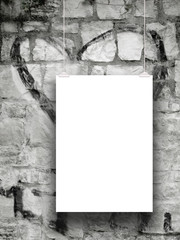 Vertical frame with clips on grey stone wall graffiti background