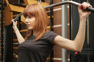 young woman fitness exercises at the gym