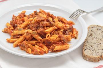 Macaroni with tomato sauce, sausage and pepper.
