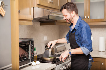 Man cooking breakfast at home