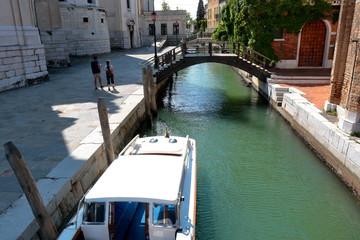 Tourists near wooden bridge over the Canal Rio della Salute