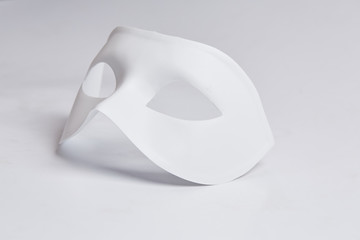 white venetian mask on a white background