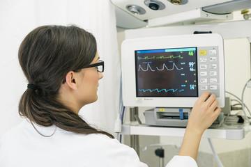 Medical doctor making ECG test in hospital.