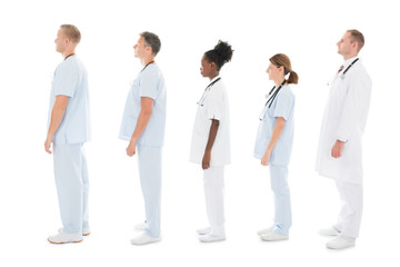 Side View Of Medical Team Standing In Row