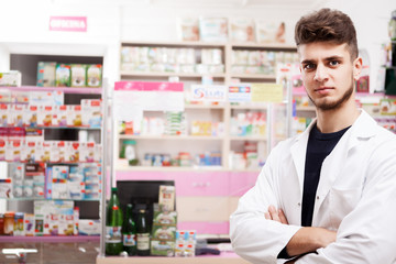 Doctor in drugstore in front of the desck