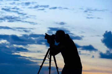 Silhouette of photographer during sunset