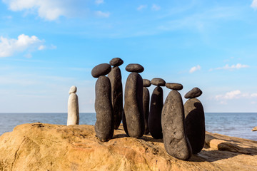 Pebbles on sea boulder