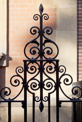 Ornate Wrought Iron Fencing. In the inner city of London ornate black wrought iron fencing is found everywhere.