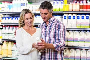 Smiling couple buying milk