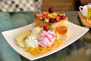 Honey toast with strawberry ice cream and honey syrup