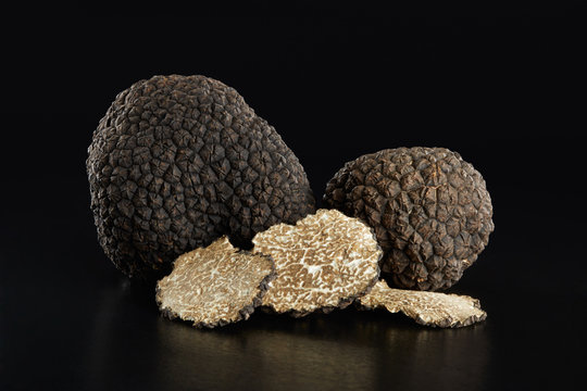 Black truffles and slices on black, clipping path included