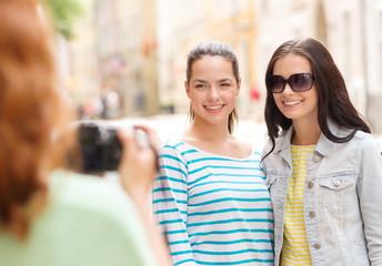 smiling teenage girls with camera