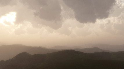 Mountain landscape in rain with stormy sky.