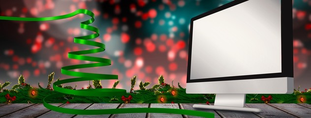 Composite image of green christmas tree ribbon