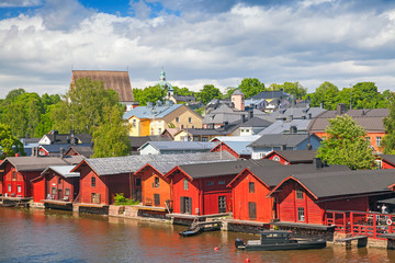 Foto auf Leinwand Skandinavien Old red wooden houses on river coast. Porvoo