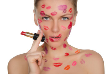 Charming woman with kisses on face in lipstick and lips