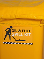 Labeled bright yellow industrial emergency spill kit, Australia 2015