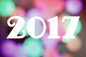 """Bright blured background with text: """"2017"""""""