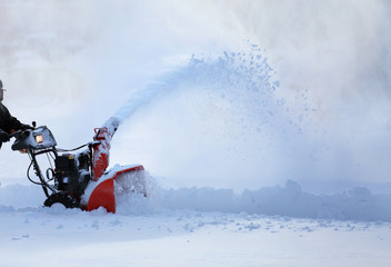 man working with snow blower