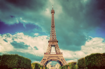 Eiffel Tower seen from Champ de Mars park in Paris, France. Vintage