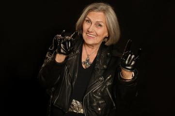 Elderly woman in leather