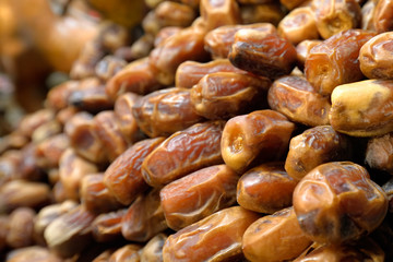Background of dried dates fruit, at the open air market.
