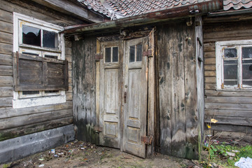 Abandoned wooden cottage door and windows.