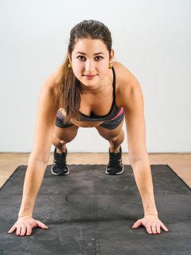 Beautiful woman doing pushups