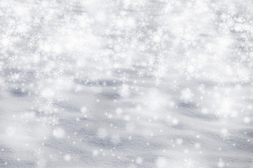Silver blue snow texture with silver snowflake background. Dreamy Christmas and New Year Holidays snow copy space background.