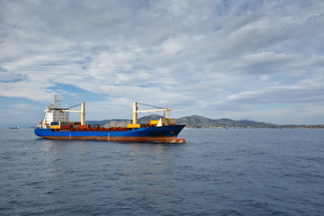 Container ship heading to the port of Piraeus, Greece