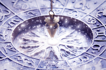 zodiac symbols with magic pendulum, concept for astrology and fortune telling